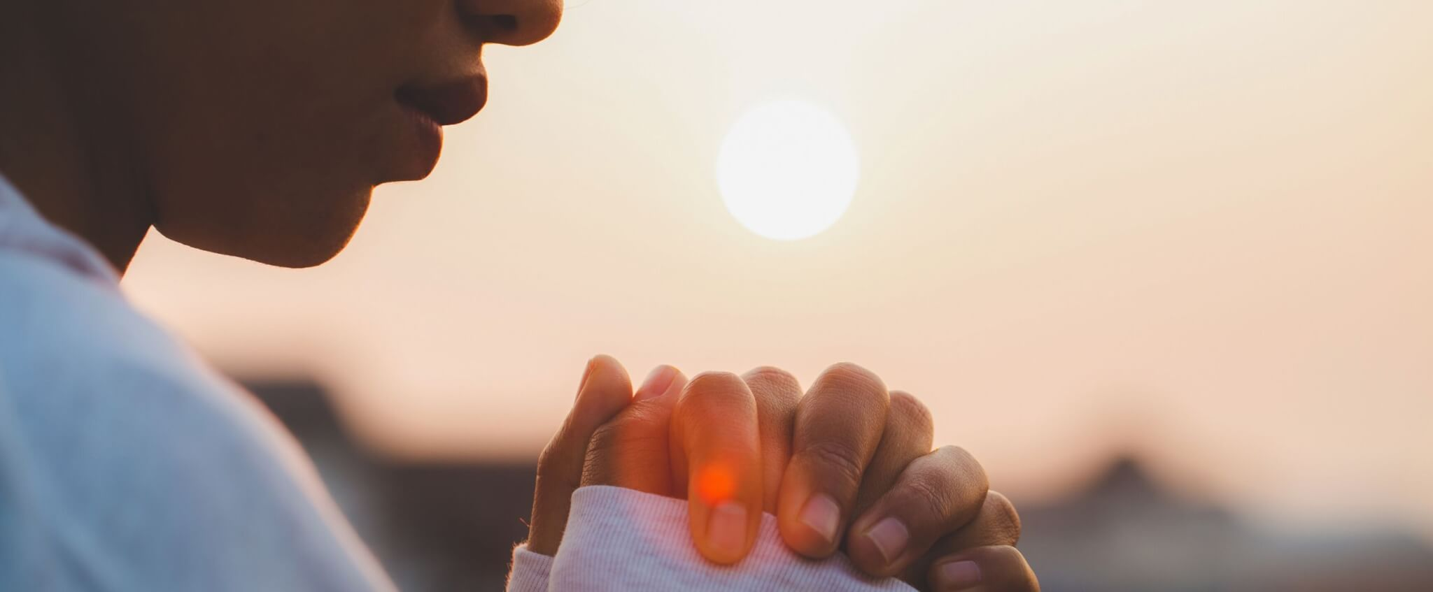 create a 24 hour prayer signup woman praying at sunrise