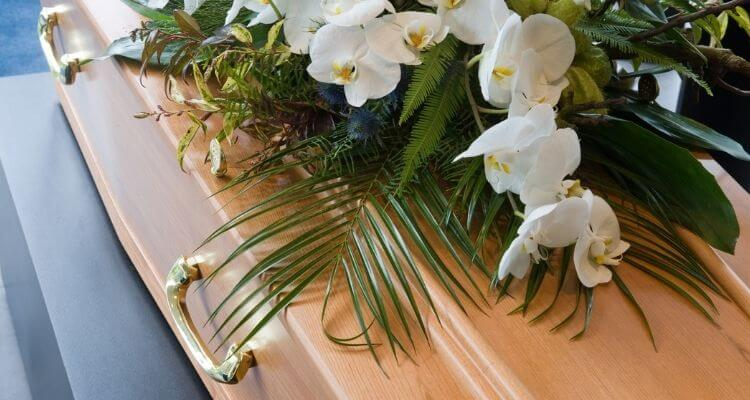 funerals during covid casket with flowers