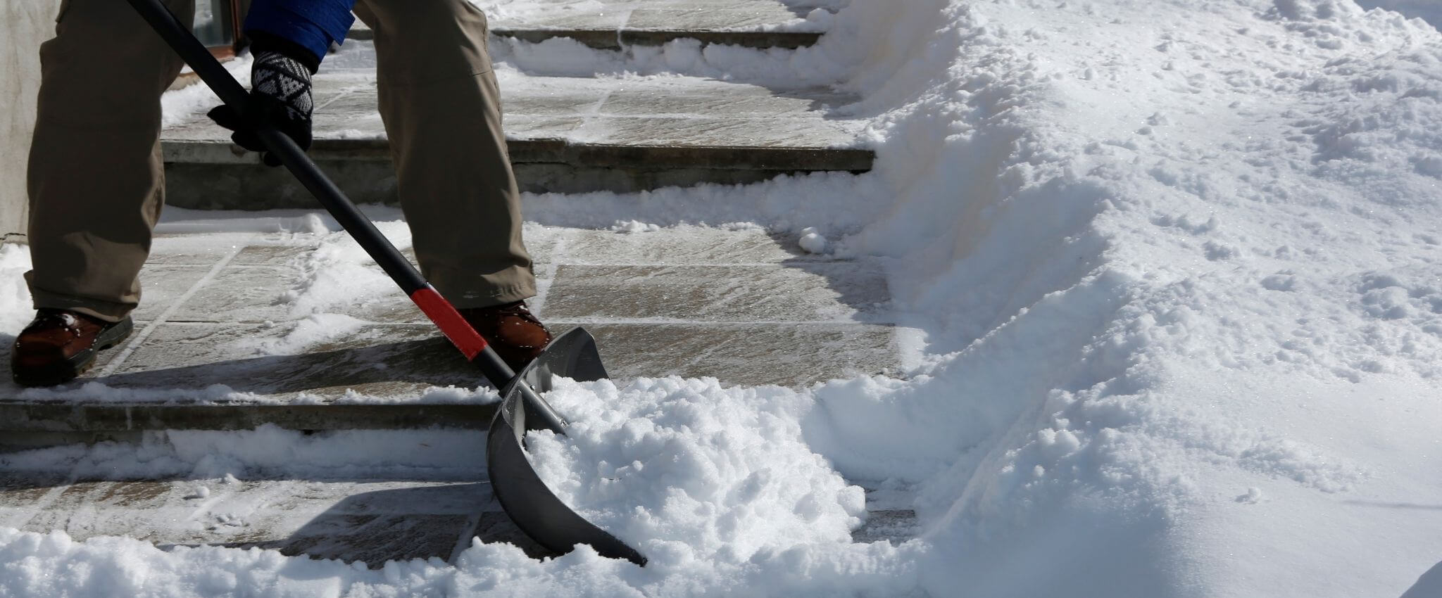 Shoveling snow - ways to help others during the holidays