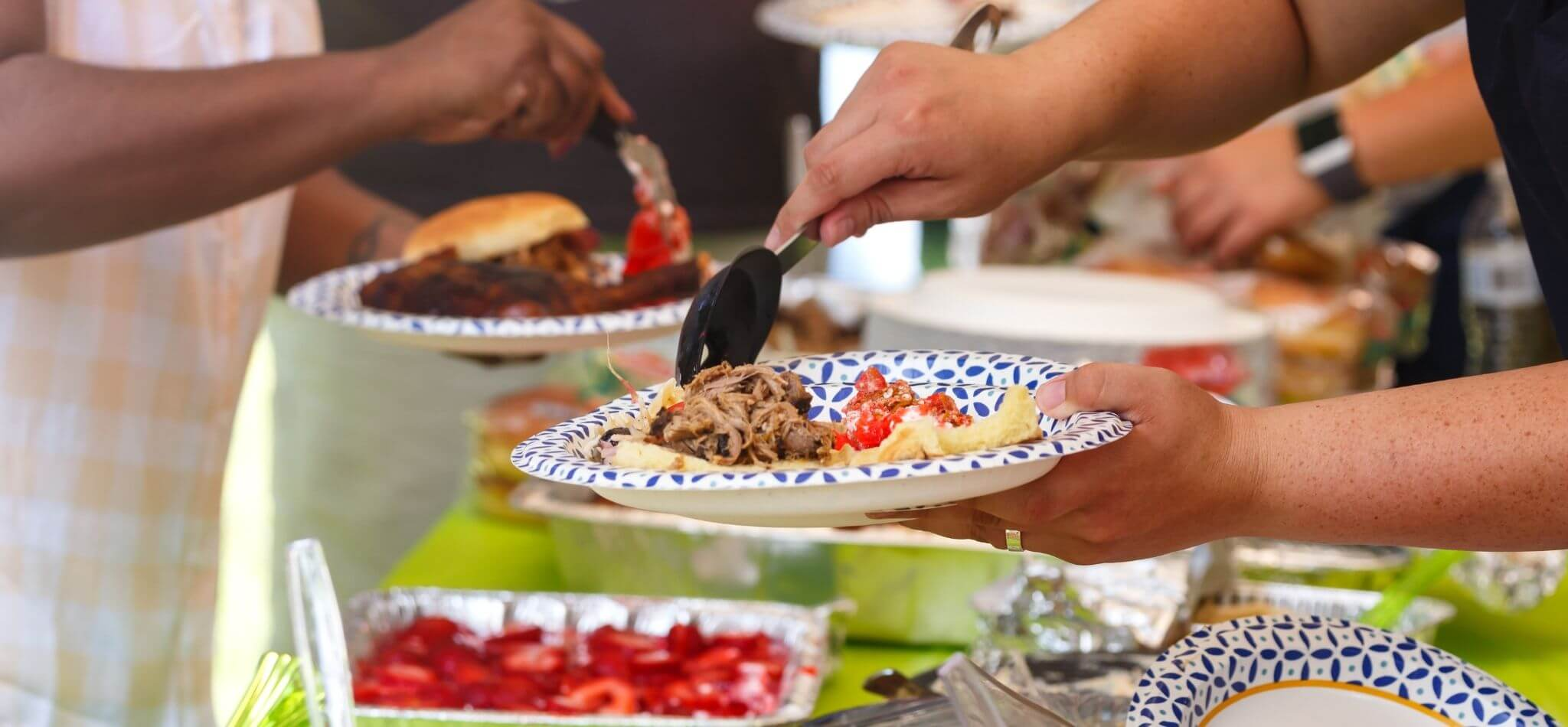 Create Potluck Signup with PlanHero hands with food